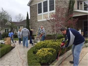 Volunteers doing yard work at Cornerstone of Hope